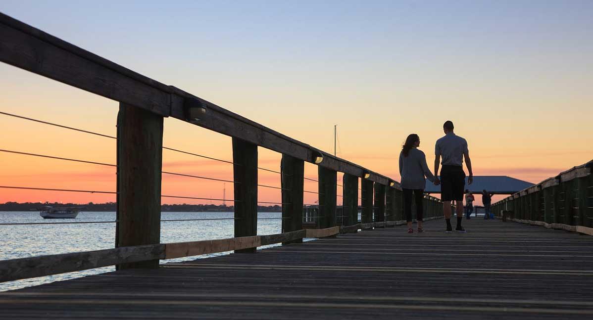 A couple walk near the river at our romanic Melbourne Beach, FL inn