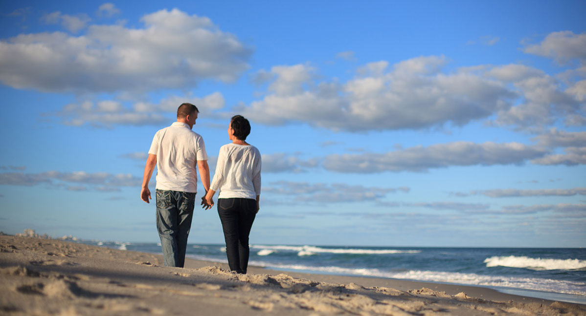 A couple walk on the shore in Melbourne, Florida