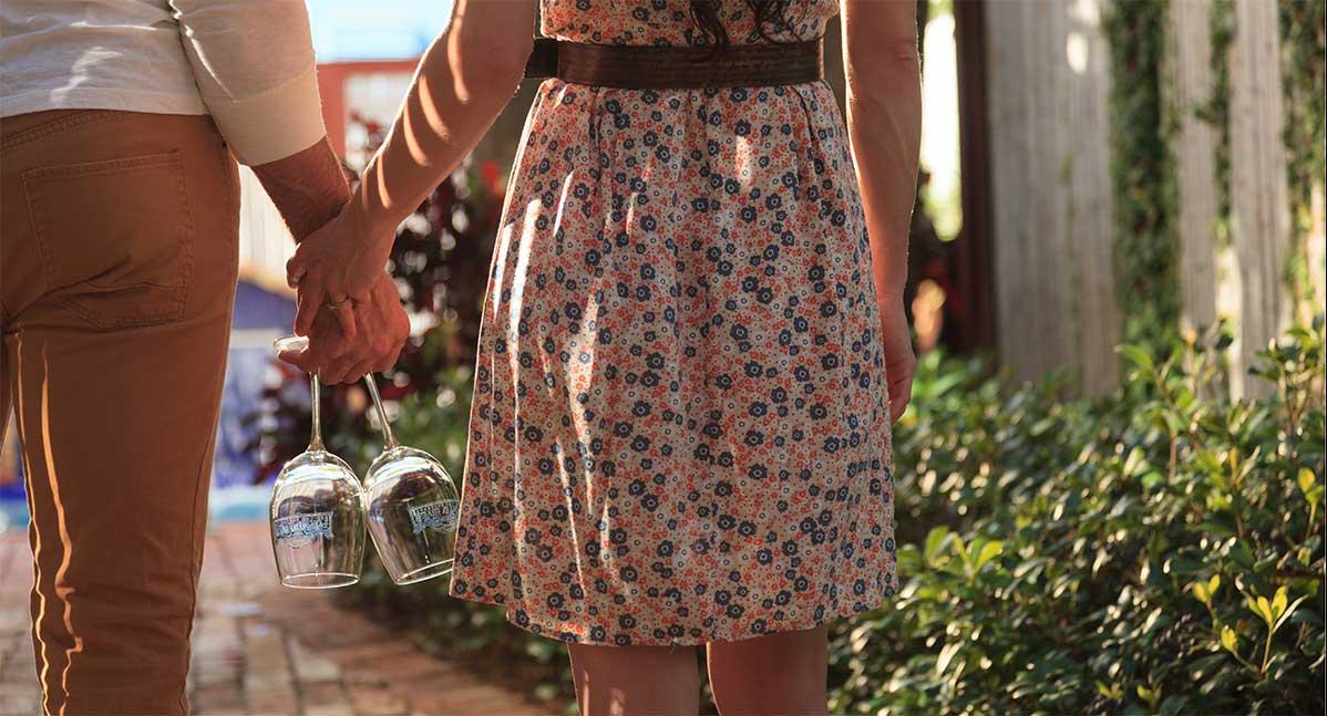 Melbourne Beach Inn - a couple walk hand in hand