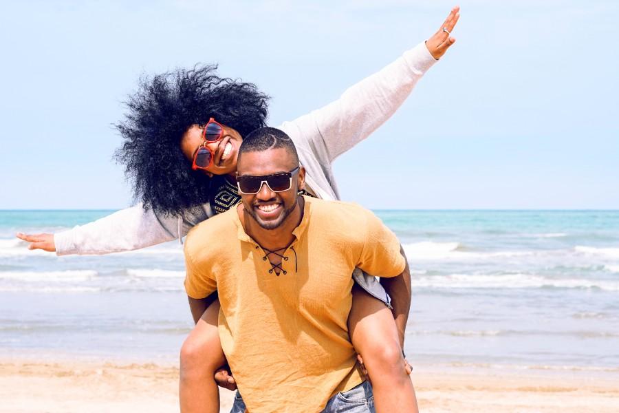 a man and woman having fun on a beach