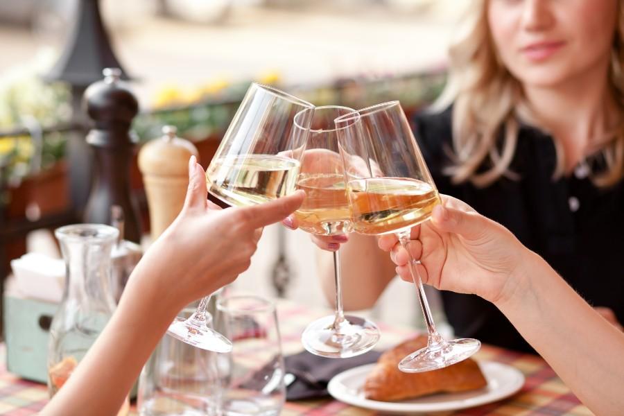 women clinking wine glasses in Melbourne Beach, Florida