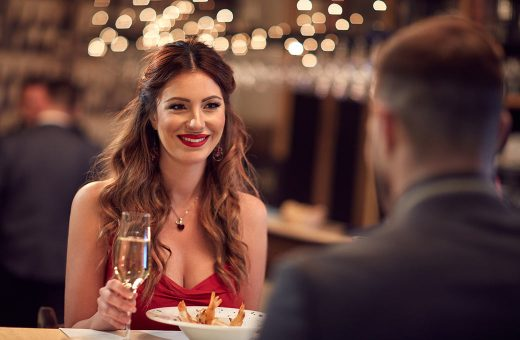 Woman looking at a man over a nice dinner