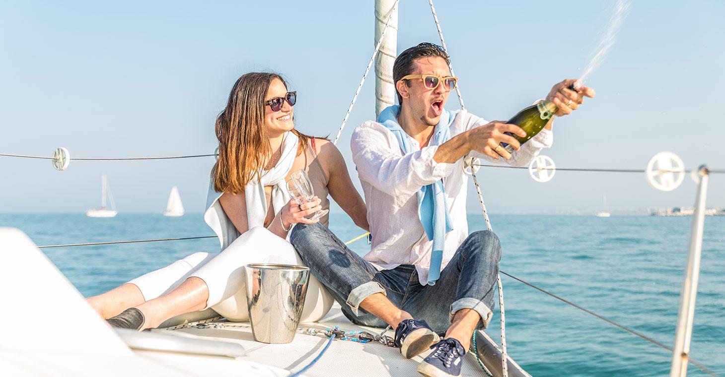 Honeymooners on a yacht celebrating