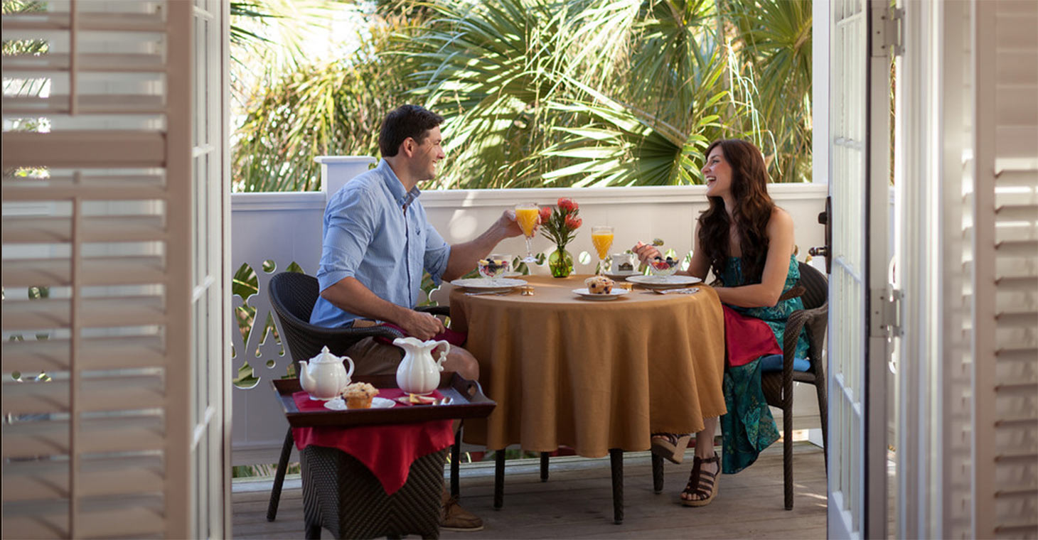 Couple eating breakfast on private patio