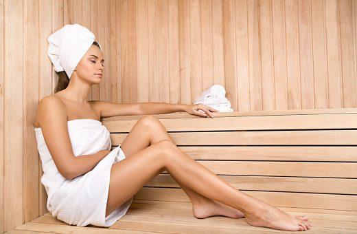 Woman sitting in the sauna