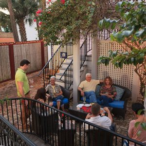 People gathered on the patio for Wine Time
