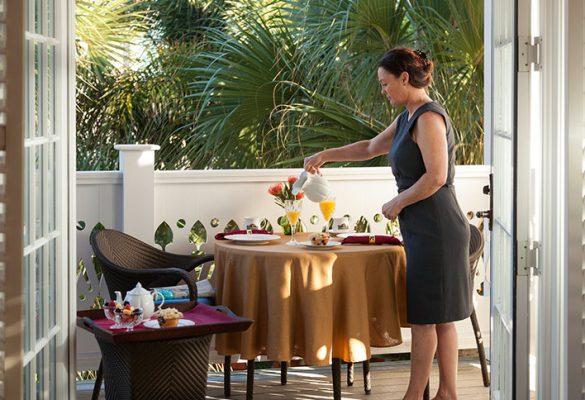 Woman preparing breakfast on the balcony