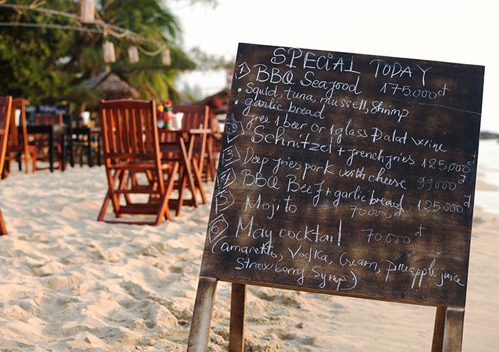 Restaurant menu board on the beach