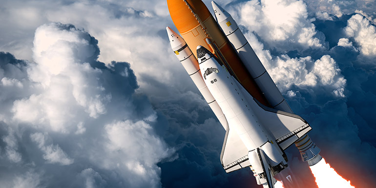 Shuttle launch in the clouds