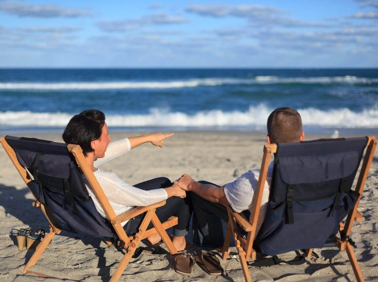 Couple sitting in chairs on the beach
