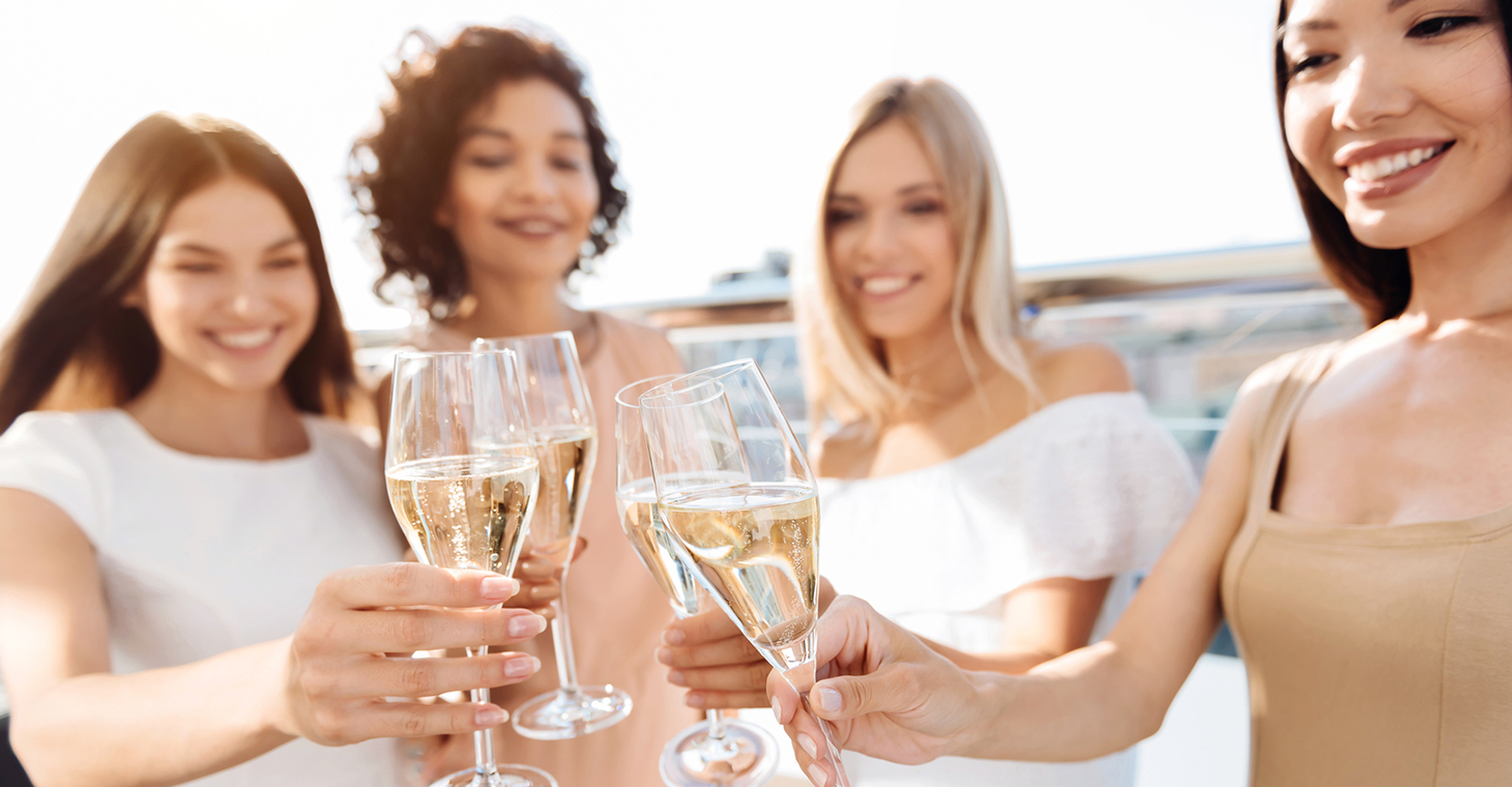 Women with champagne on the beach
