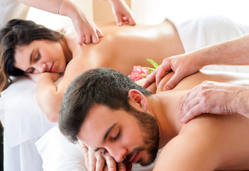 Man and woman getting a relaxing massage