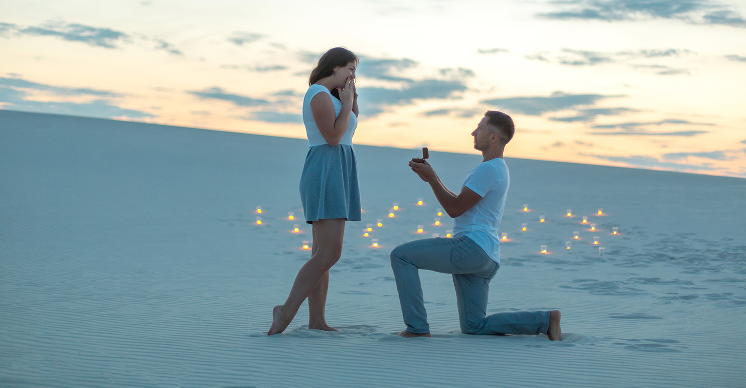 Guy on Bended Knee Beach Proposal