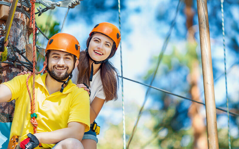 smiling couple on aerial adventure at Brevard Zoo