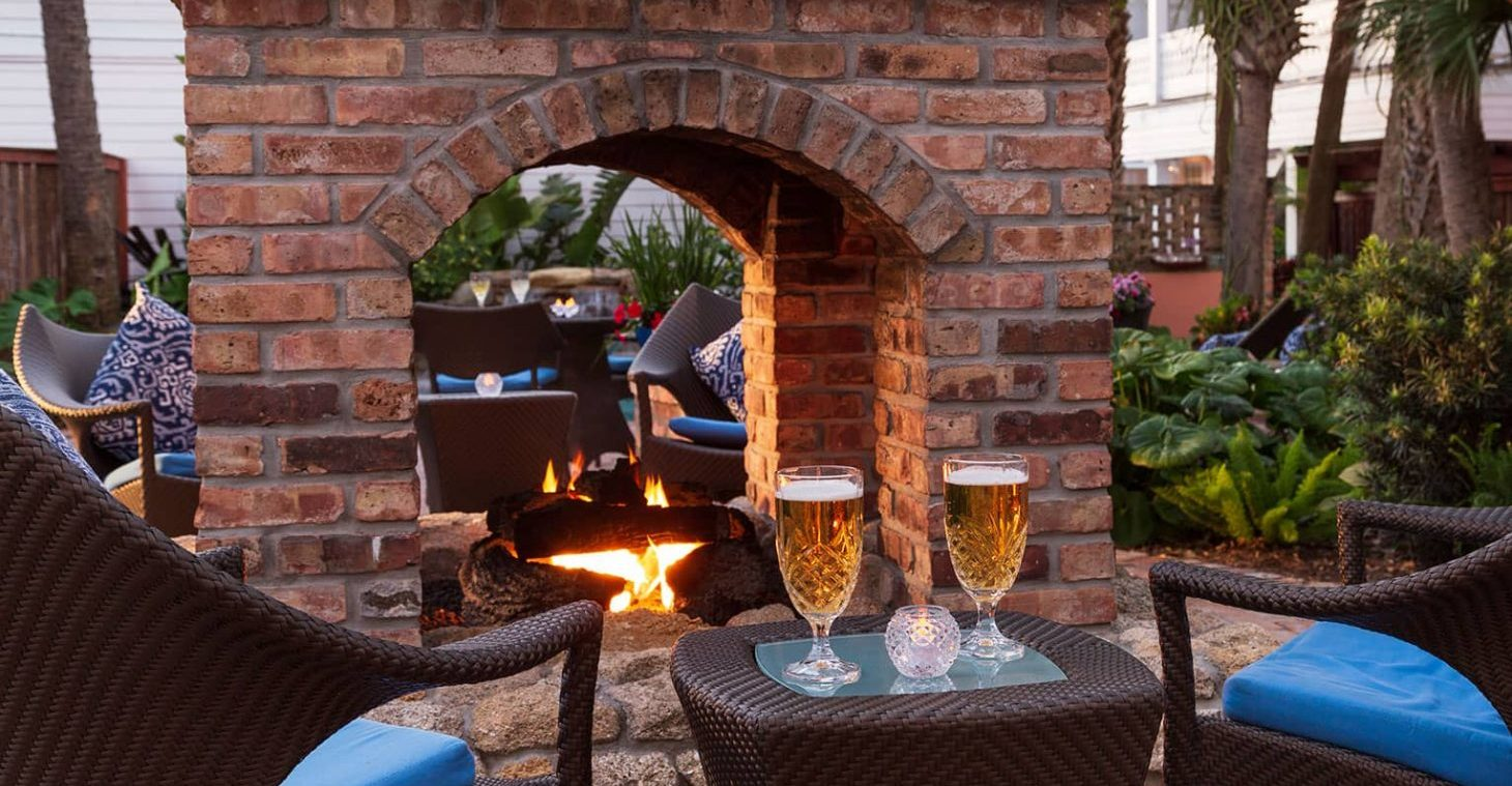Beers by the fire pit at our boutique hotel in Melbourne Beach, FL