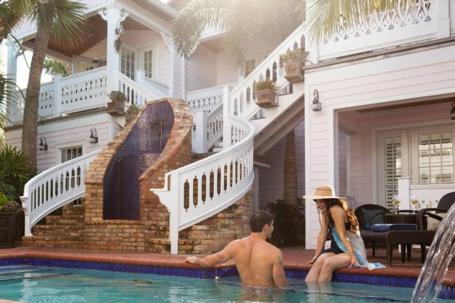 a young couple lounging by a pool