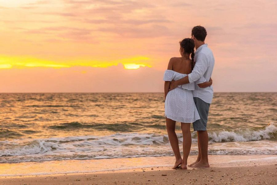 Couple Watching Sunset at One of the Best Places to Honeymoon in Florida