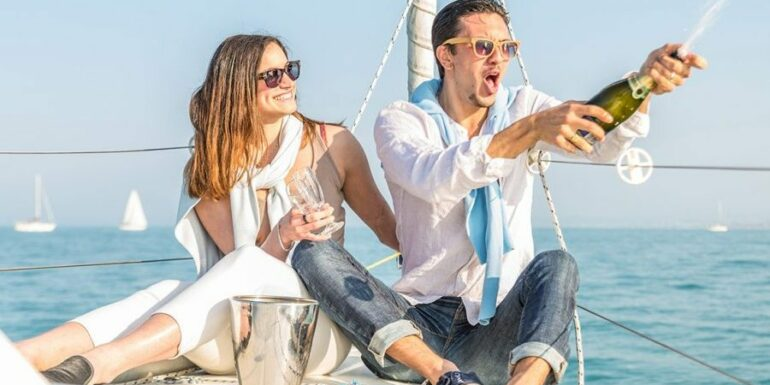 Couple popping a bottle of champagne on a boat in florida