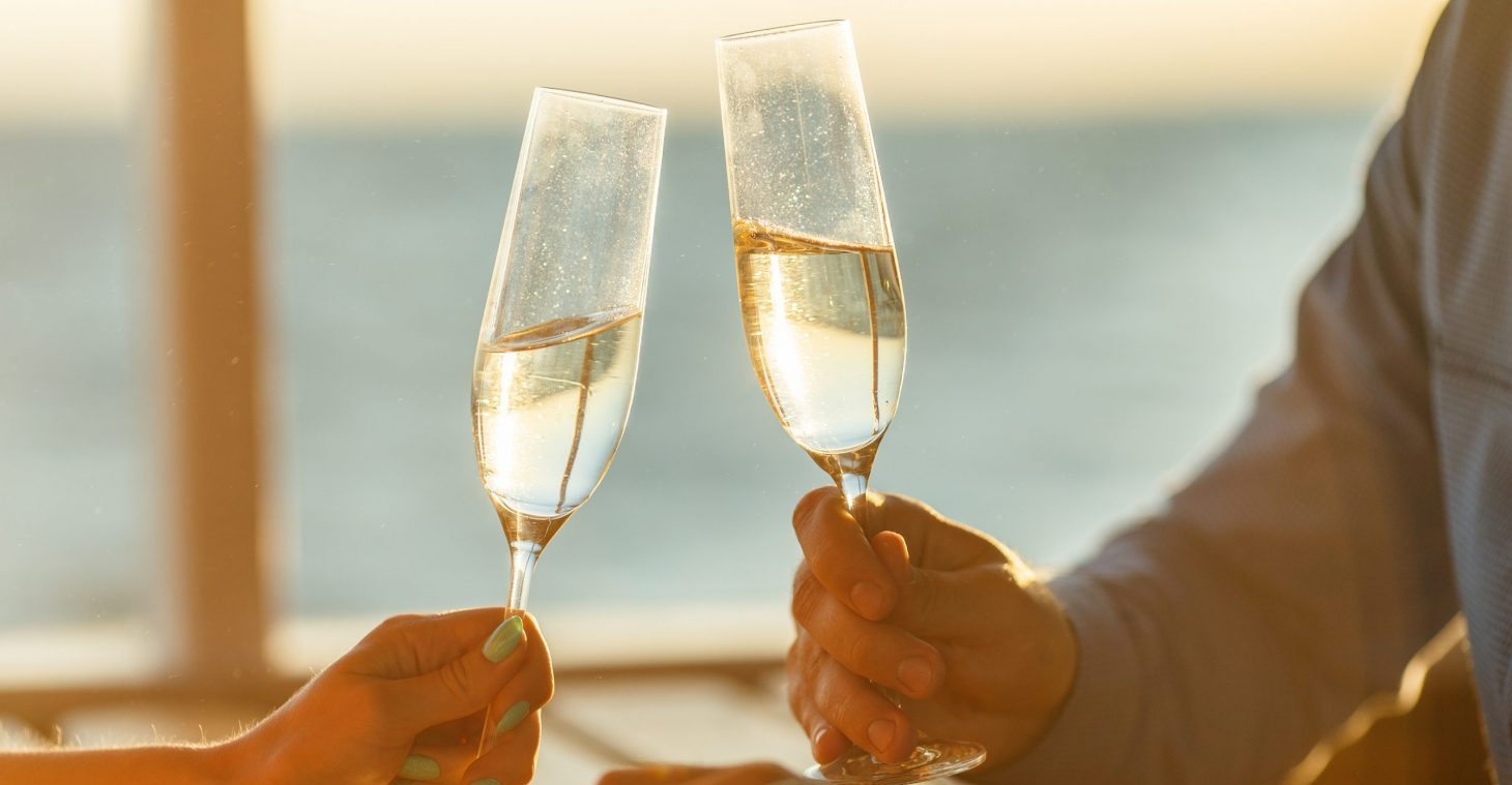 Toasting champagne by the ocean on a romantic getaway in FL