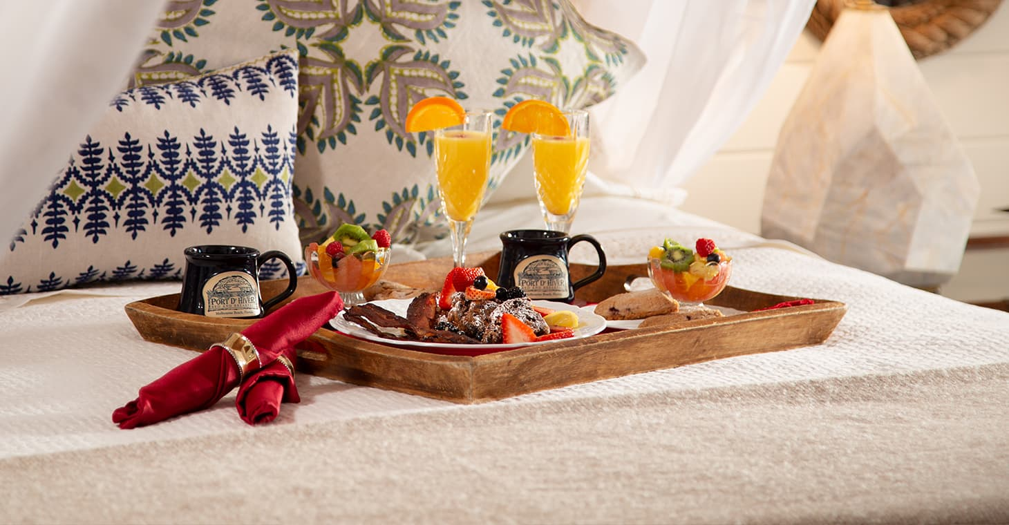 Breakfast in bed at our hotel in Melbourne Beach, Florida