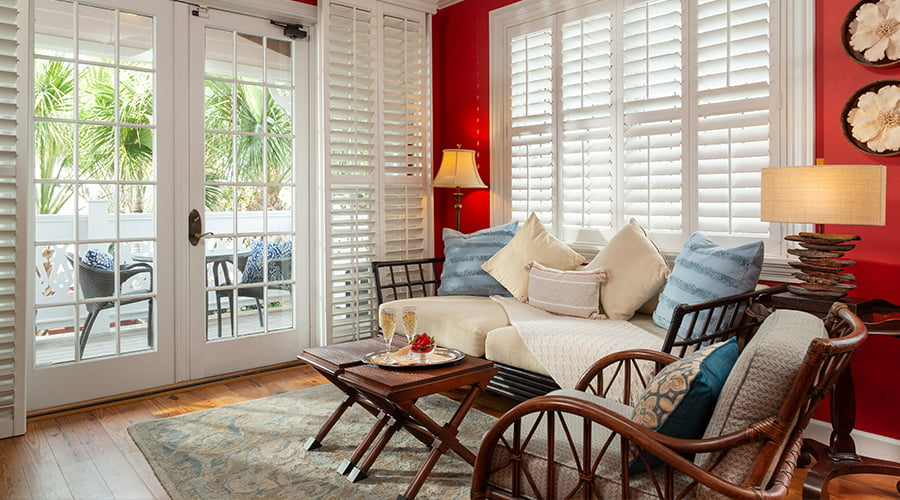 Windward Room bed and sitting area for a fall getaway in Melbourne Beach, Florida